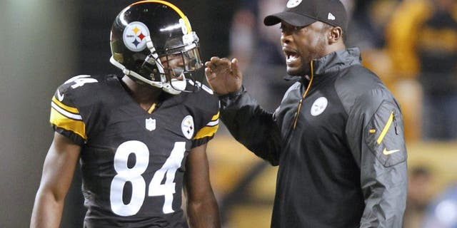 Sep 22, 2013; Pittsburgh, PA, USA; Pittsburgh Steelers wide receiver Antonio Brown (84) and Steelers head coach Mike Tomlin talk before playing the Chicago Bears at Heinz Field. Mandatory Credit: Charles LeClaire-USA TODAY Sports