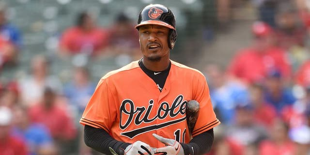 ARLINGTON, TX - AUGUST 30: Adam Jones #10 of the Baltimore Orioles looks off the field at the crowd as he walks back to the dugout after striking out in the game against the Texas Rangers at Globe Life Park in Arlington on August 30, 2015 in Arlington, Texas. The Texas Rangers defeated the Baltimore Orioles 6-0. (Photo by John Williamson/MLB Photos via Getty Images)