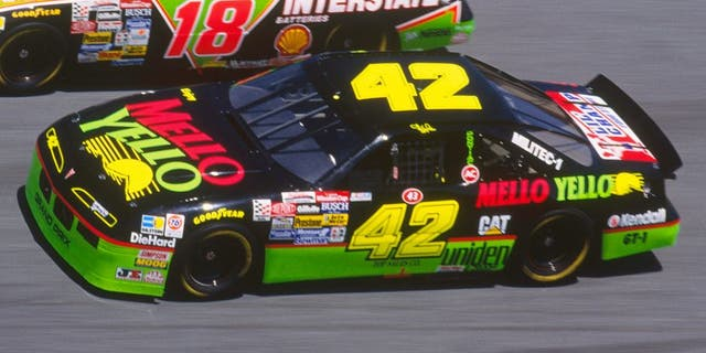 Dale Jarrett drives his Interstate Batteries #18 car down a turn against Kyle Petty in his Mello Yello #42 car during the Daytona 500 at the Daytona Speedway on February 14, 1993 in Daytona Beach, Florida. (Photo by Focus on Sport/Getty Images)
