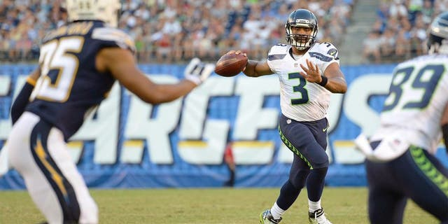 Aug 29, 2015; San Diego, CA, USA; Seattle Seahawks quarterback Russell Wilson (3) looks to pass during the third quarter against the San Diego Chargers at Qualcomm Stadium. Mandatory Credit: Jake Roth-USA TODAY Sports