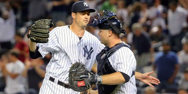 Sep 4, 2015; Bronx, NY, USA; New York Yankees relief pitcher Andrew Miller (48) and catcher Brian McCann (34) celebrate the win against the Tampa Bay Rays at Yankee Stadium. New York Yankees won 5-2. Mandatory Credit: Anthony Gruppuso-USA TODAY Sports