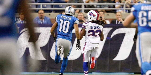 Sep 3, 2015; Detroit, MI, USA; Buffalo Bills cornerback Ron Brooks (33) makes an interception for a touchdown and is chased by Detroit Lions wide receiver Corey Fuller (10) during the first quarter of a preseason NFL football game at Ford Field. Mandatory Credit: Raj Mehta-USA TODAY Sports