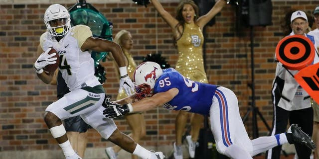 Baylor wide receiver Jay Lee (4) runs past SMU defensive lineman Andrew McCleneghen (95) on his way to scoring a touchdown during the second half of an NCAA college football game Friday, Sept. 4, 2015, in Dallas. (AP Photo/LM Otero)