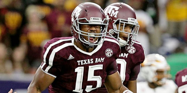 Sep 5, 2015; Houston, TX, USA; Texas A&M Aggies defensive lineman Myles Garrett (15) celebrates his sack against Arizona State Sun Devils quarterback Mike Bercovici (2) (not pictured)in the first quarter at NRG Stadium. Mandatory Credit: Thomas B. Shea-USA TODAY Sports