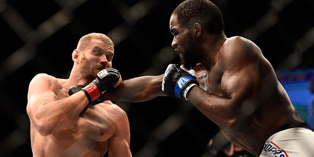 LAS VEGAS, NV - SEPTEMBER 05: (R-L) Corey Anderson punches Jan Blachowicz in their light heavyweight bout during the UFC 191 event inside MGM Grand Garden Arena on September 5, 2015 in Las Vegas, Nevada. (Photo by Jeff Bottari/Zuffa LLC/Zuffa LLC via Getty Images)