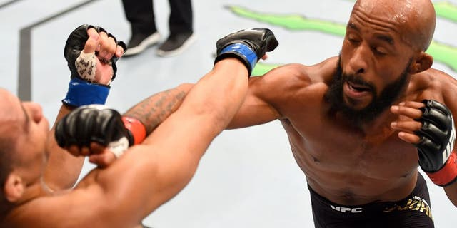 LAS VEGAS, NV - SEPTEMBER 05: (R-L) Demetrious Johnson punches John Dodson in their flyweight championship bout during the UFC 191 event inside MGM Grand Garden Arena on September 5, 2015 in Las Vegas, Nevada. (Photo by Josh Hedges/Zuffa LLC/Zuffa LLC via Getty Images)