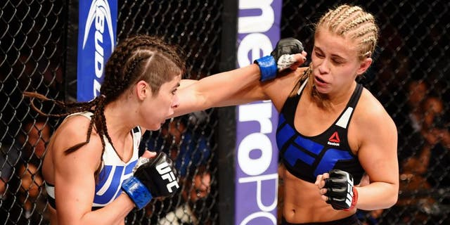 LAS VEGAS, NV - SEPTEMBER 05: (L-R) Alex Chambers punches Paige VanZant in their women's strawweight bout during the UFC 191 event inside MGM Grand Garden Arena on September 5, 2015 in Las Vegas, Nevada. (Photo by Josh Hedges/Zuffa LLC/Zuffa LLC via Getty Images)