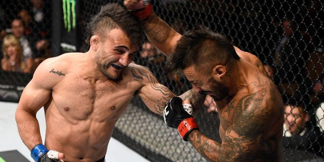 LAS VEGAS, NV - SEPTEMBER 05: (L-R) John Lineker punches Francisco Rivera in their bantamweight bout during the UFC 191 event inside MGM Grand Garden Arena on September 5, 2015 in Las Vegas, Nevada. (Photo by Jeff Bottari/Zuffa LLC/Zuffa LLC via Getty Images)