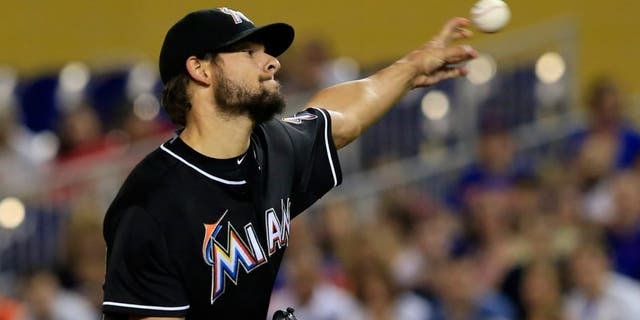 Sep 5, 2015; Miami, FL, USA; Miami Marlins pitcher Brad Hand (52) throws a pitch in the first inning of a game against the New York Mets at Marlins Park. Mandatory Credit: Robert Mayer-USA TODAY Sports