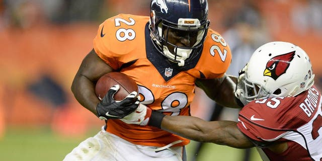 Sep 3, 2015; Denver, CO, USA; Denver Broncos running back Montee Ball (28) is tackled by Arizona Cardinals defensive back Cariel Brooks (35) in the third quarter of a preseason game at Sports Authority Field at Mile High. The Cardinals defeated the Broncos 22-20. Mandatory Credit: Ron Chenoy-USA TODAY Sports