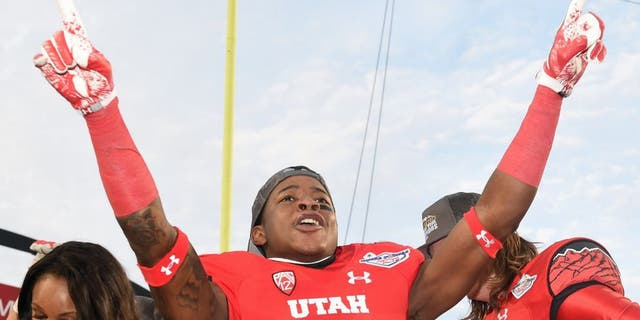 LAS VEGAS, NV - DECEMBER 20: Wide receiver Dominique Hatfield #15 of the Utah Utes celebrates after the team defeated the Colorado State Rams 45-10 in the Royal Purple Las Vegas Bowl at Sam Boyd Stadium on December 20, 2014 in Las Vegas, Nevada. (Photo by Ethan Miller/Getty Images)