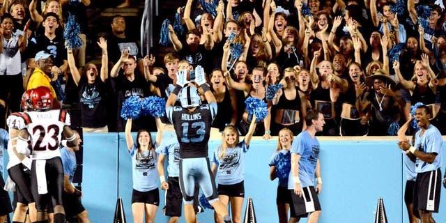Sep 6, 2014; Chapel Hill, NC, USA;North Carolina Tar Heels receiver Mack Hollins (13) celebrates a touchdown with fans during the second half against the San Diego State Aztecs at Kenan Memorial Stadium. North Carolina won 31-27. Mandatory Credit: Rob Kinnan-USA TODAY Sports