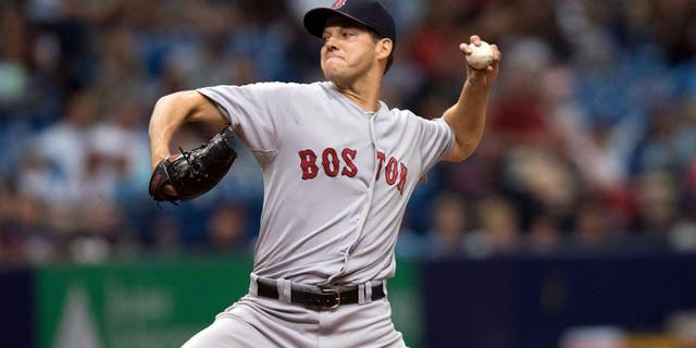 Sep 13, 2015; St. Petersburg, FL, USA; Boston Red Sox starting pitcher Rich Hill (62) delivers a pitch in the second inning against the Tampa Bay Rays at Tropicana Field. Mandatory Credit: Jeff Griffith-USA TODAY Sports