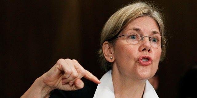 FILE: July 21, 2011: Elizabeth Warren, as head of the Congressional Oversight Panel, testifies before a Senate Finance Committee.