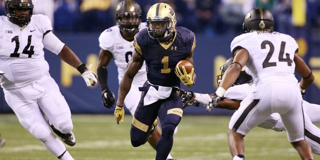 Sep 13, 2014; Indianapolis, IN, USA; Notre Dame Fighting Irish running back Greg Bryant (1) runs with the ball against the Purdue Boilermakers at Lucas Oil Stadium. Mandatory Credit: Brian Spurlock-USA TODAY Sports