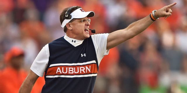 MANHATTAN, KS - SEPTEMBER 18: Head coach Gus Malzahn of the Auburn Tigers calls out instructions against the Kansas State Wildcats during the first half on September 18, 2014 at Bill Snyder Family Stadium in Manhattan, Kansas. (Photo by Peter G. Aiken/Getty Images)