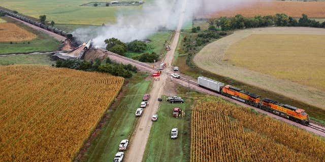 Smoke rises from a burning ethanol tanker car, Saturday Sept. 19, 2015, after the 98-car BNSF train carrying ethanol derailed in a rural part of Bon Homme County awash in corn fields between the towns of Scotland and Lesterville, S.D.