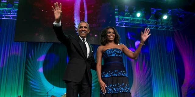 Sept. 19, 2015: President Barack Obama and first lady Michelle Obama arrive at the Congressional Black Caucus Foundation's 45th Annual Legislative Conference Phoenix Awards Dinner at the Walter E. Washington Convention Center in Washington.