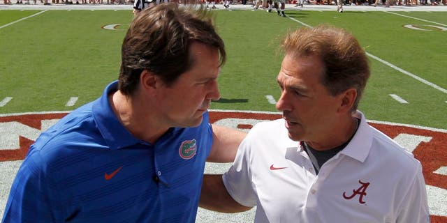 Florida head coach Will Muschamp, left, talks with Alabama coach Nick Saban before an NCAA college football game against on Saturday, Sept. 20, 2014, in Tuscaloosa, Ala. (AP Photo/Butch Dill)