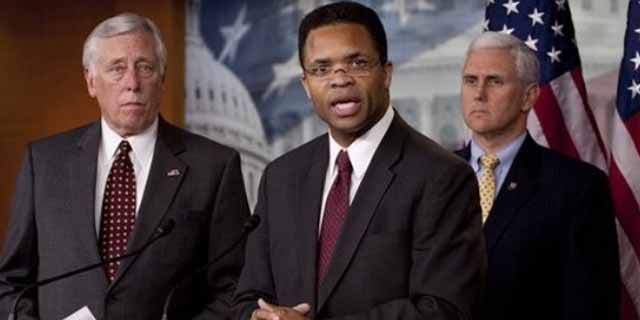April 14: Rep. Jesse Jackson Jr., D-Ill., flanked by House Majority Leader Steny Hoyer of Md., left, and Rep. Mike Pence, R-Ind., addresses a news conference on Capitol Hill in Washington.