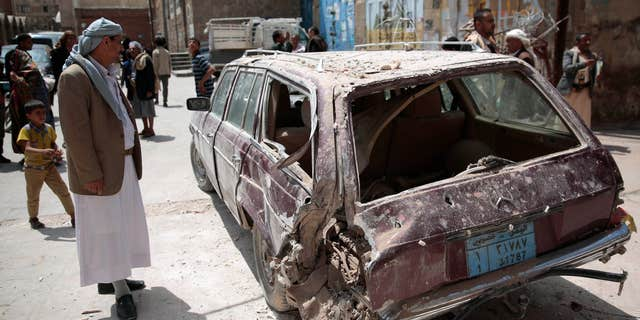 Sept. 20, 2016: A Yemeni man looks at a damaged car after an airstrike by Saudi-led coalition in Sanaa, Yemen.