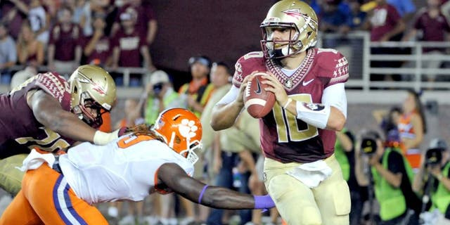 Sep 20, 2014; Tallahassee, FL, USA; Florida State Seminoles quarterback Sean Maguire (10) is pressured during the first half against the Clemson Tigers at Doak Campbell Stadium. Mandatory Credit: Melina Vastola-USA TODAY Sports