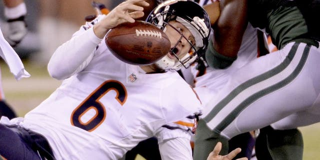 Sep 22, 2014; East Rutherford, NJ, USA; Chicago Bears quarterback Jay Cutler (6) fumbles the ball during the first half against the New York Jets at MetLife Stadium. Mandatory Credit: Robert Deutsch-USA TODAY Sports