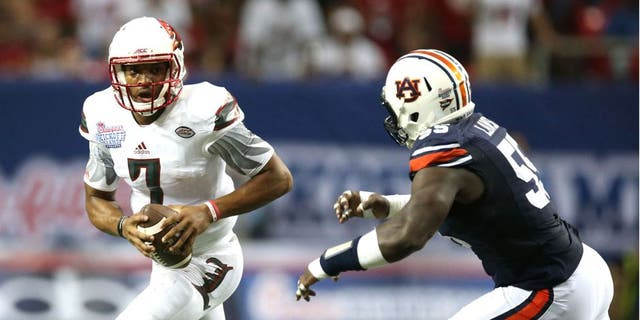 Sep 5, 2015; Atlanta, GA, USA; Louisville Cardinals quarterback Reggie Bonnafon (7) is chased by Auburn Tigers defensive lineman Carl Lawson (55) and Kris Frost (17) during the second quarter in the 2015 Chick-fil-A Kickoff Game at the Georgia Dome. Mandatory Credit: Jason Getz-USA TODAY Sports