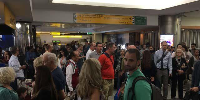 Sept. 22, 2016: Passengers evacuate LaGuardia Airport terminal B.