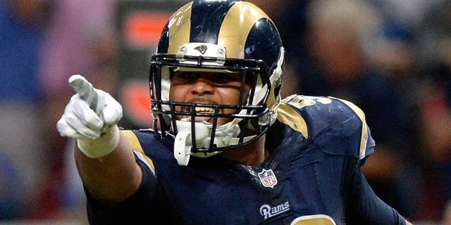 Sep 13, 2015; St. Louis, MO, USA; St. Louis Rams defensive tackle Aaron Donald (99) celebrates after sacking Seattle Seahawks quarterback Russell Wilson (not pictured) during the second half at the Edward Jones Dome. The Rams defeated the Seahawks 34-31 in overtime. Mandatory Credit: Jeff Curry-USA TODAY Sports