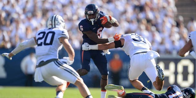 Sep 20, 2014; Provo, UT, USA; Virginia Cavaliers wide receiver Darius Jennings (6) shakes the tackle of Brigham Young Cougars linebacker Sae Tautu (31) during the second half at Lavell Edwards Stadium. The Cougars won the game 41-33. Mandatory Credit: Joe Camporeale-USA TODAY Sports