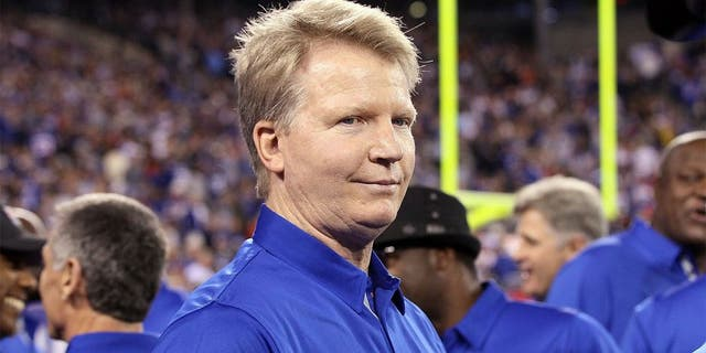 EAST RUTHERFORD, NJ - SEPTEMBER 19: (NEW YORK DAILIES OUT) Former Giant Phil Simms looks on at halftime as the 1986 New York Giants are honored on the 25th anniversary of their Super Bowl winning team on September 19, 2011 at MetLife Stadium in East Rutherford, New Jersey. The Giants defeated the Rams 28-16. (Photo by Jim McIsaac/Getty Images)