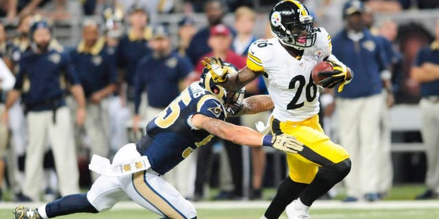 Sep 27, 2015; St. Louis, MO, USA; Pittsburgh Steelers running back Le'Veon Bell (26) carries the ball away from St. Louis Rams middle linebacker James Laurinaitis (55) during the first half at The Edward Jones Dome. Mandatory Credit: Joshua Lindsey-USA TODAY Sports