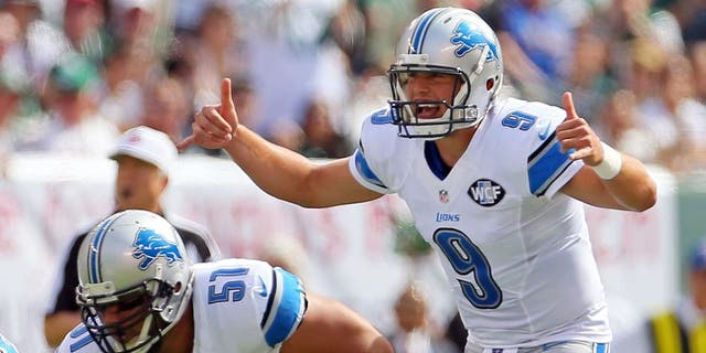 Sep 28, 2014; East Rutherford, NJ, USA; Detroit Lions quarterback Matthew Stafford (9) gestures against the New York Jets during the first quarter at MetLife Stadium. Mandatory Credit: Adam Hunger-USA TODAY Sports