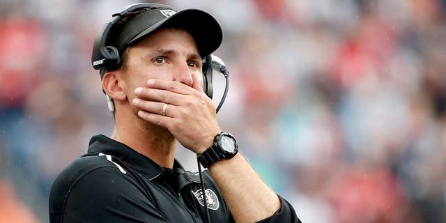 Sep 21, 2014; Foxborough, MA, USA; Oakland Raiders head coach Dennis Allen looks on during the final moments of their 16-9 loss to the New England Patriots at Gillette Stadium. Mandatory Credit: Winslow Townson-USA TODAY Sports