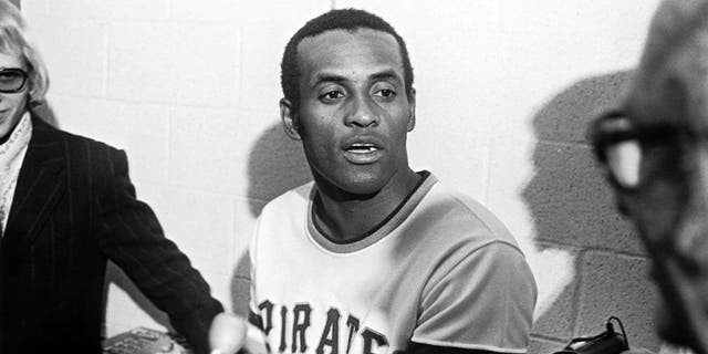 PITTSBURGH - Roberto Clemente #21 of the Pittsburgh Pirates talks to the media after getting his 3000th hit against the New York Mets at Three Rivers Stadium on September 30, 1972 in Pittsburgh, Pennsylvania. (Photo by: Morris Berman/MLB Photos via Getty Images)