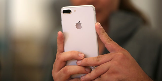 File photo: A customer views the new iPhone 7 smartphone inside an Apple Inc. store in Los Angeles, California, U.S., September 16, 2016. (REUTERS/Lucy Nicholson)