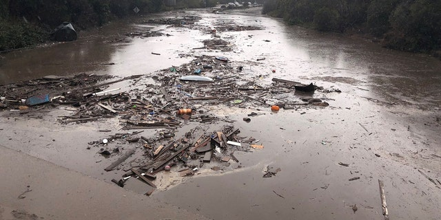 Debris floats in flooded waters on the freeway after a mudslide in Montecito, California, U.S. in this photo provided by the Santa Barbara County Fire Department, January 9, 2018.
