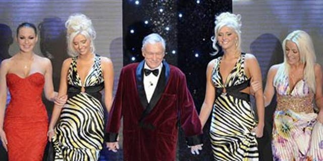 """Feb. 20: Hugh Hefner arrives with his girlfriends at the """"Festival di Sanremo"""" Italian song contest, in San Remo, Italy."""