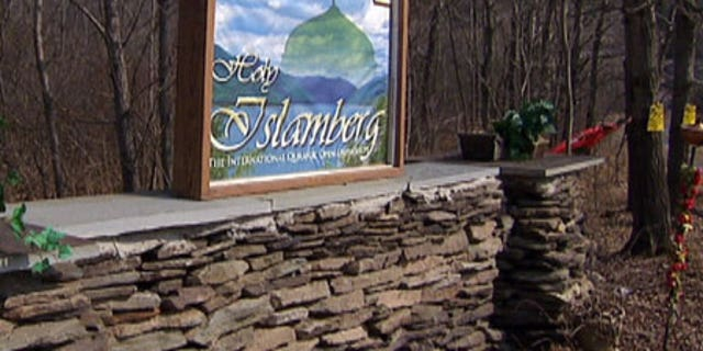 The gate to Islamberg, N.Y., a private Muslim community that is home to an estimated 100 residents. The sign reads: 'Welcome to Holy Islamberg, The International Quranic Open University.'