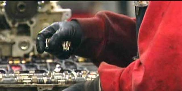 A worker handles parts at a Yamato Engine Specialists plant in Washington where Immigration and Customs Enforcement officials arrested 28 in a February raid.