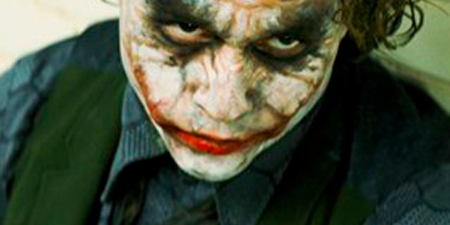"""In this image released by Warner Bros., Heath Ledger stars as The Joker in """"The Dark Knight.""""  Ledger is an overwhelming favorite to become, on Sunday, only the second actor to win a posthumous Oscar. If he does, the words """"Oscar-winning actor"""" will doubtless precede each mention of his name forever. But beyond that, what will his legacy be? (AP Photo/Warner Bros. Pictures) ** NO SALES **"""
