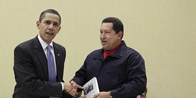 "April 18: Venezuela's President Hugo Chavez hands President Obama the book titled ""The Open Veins of Latin America"" by Eduardo Galeano."