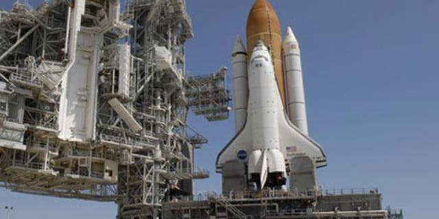 The space shuttle Endeavour sits atop Pad 39A at NASA's seaside Kennedy Space Center launch complex.