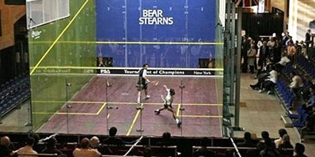 Jan. 10, 2008: Anwar Reda, left, of Egypt, watches as countryman Mohammed Abbas goes for a shot in the Tournament of Champions in New York.