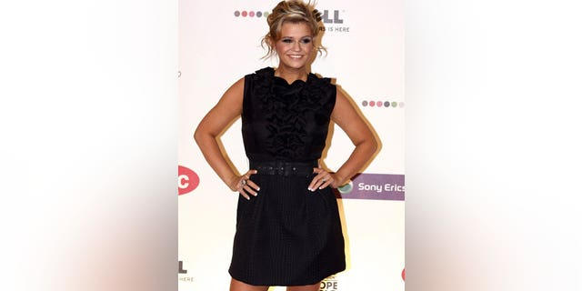 Kerry Katona's unauthorized breast implant had to be removed from auction by eBay.