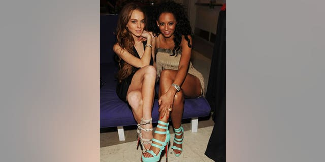 """Lindsay Lohan catches up with Mel B. of the Las Vegas topless revue """"Peep Show."""" Could Lindsay be gearing up to take Kelly Monaco's place in the show?"""