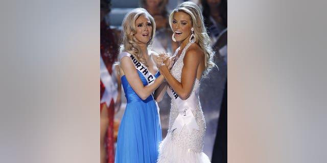 Former Miss California Carrie Prejean, right, congratulates winner, Miss North Carolina Kristen Dalton at the Miss USA pageant.
