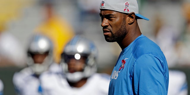 Detroit Lions wide receiver Calvin Johnson watches as his teammates warm up before an NFL football game against the Green Bay Packers Sunday, Oct. 6, 2013, in Green Bay, Wis. Johnson had been sidelined two days last week with a knee injury and was declared inactive for Sunday's game. (AP Photo/Jeffrey Phelps)