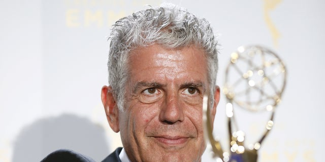"""Anthony Bourdain poses with the outstanding informational series or special award for """"Anthony Bourdain Parts Unknown"""" backstage at the 2015 Creative Arts Emmy Awards in Los Angeles, California September 12, 2015. REUTERS/Danny Moloshok - RTSTQP"""